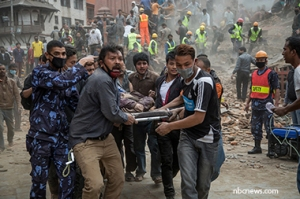 KATHMANDU, NEPAL - APRIL 25: Emergency rescue workers carry a victim on a stretcher after Dharara tower collapsed on April 25, 2015 in Kathmandu, Nepal. More than 100 people have died as tremors hit Nepal after an earthquake measuring 7.9 on the Richter scale caused buildings to collapse and avalanches to be triggered in the Himalayas. Authorities have warned that the death toll is likely to be much higher. (Photo by Omar Havana/Getty Images) *** BESTPIX ***